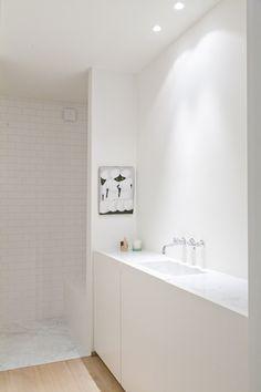 Annemarie van Riet, Belgium. Light timber floor, marble, white tiles, white plaster