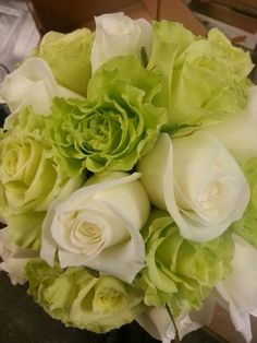 Lime green  and white rose in bridesmaid bouquet.