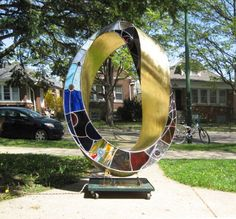 Leaded stained glass, bronze, LED lights Abstract Contemporary or Modern Outdoor Outside Exterior Garden / Yard Sculptures Statues statuary #sculpture by #sculptor Plamen Yordanov titled: 'Light Infinity (Coloured Mobius Strip/Ring statues)'. #art #artist #artwork #PlamenYordanov