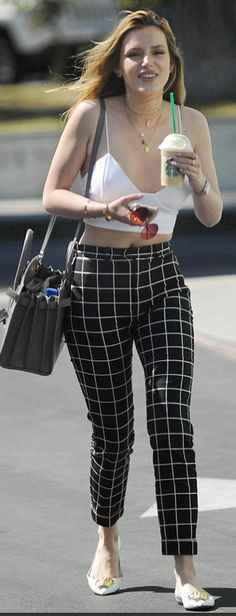 Who made Bella Thorne's gold jewelry, black check print pants, and gray tote handbag?