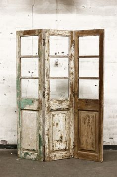 reclaimed old doors turned vintage folding screen... Maybe put canvas or burlap…