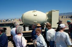 """Tourists at the Trinity Site in New Mexico, where the first atomic bomb was exploded in a test, examine a """"Fat Man"""" bomb casing like the one that detonated over Nagasaki, Japan, on August 9, 1945, three days after the bombing of Hiroshima. More from: http://www.picture1000.com"""