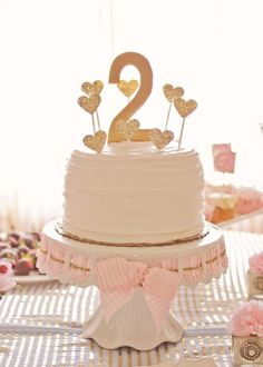 Pink and Gold 2nd Birthday Party Cake - super-simple gold glitter heart cake toppers!