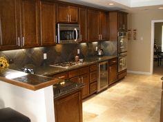 slate backsplash & granite countertop | ... entryway beautiful travertine stone fireplace with gas starter in den