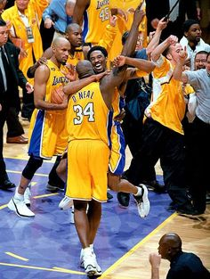 Claiming their first championship together, a jubilant Kobe Bryant and an emotional Shaquille O'Neal celebrate and share a rare hug. Copyrights may apply. All rights reserved.
