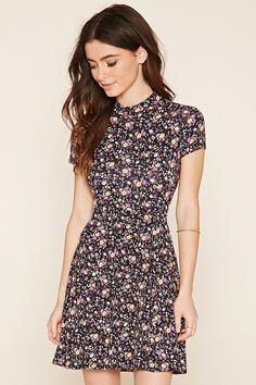 """Floral Print Skater Dress A stretch-knit skater dress featuring a floral print, mock neck, and short sleeves. 6% rayon, 4% spandex - Hand wash cold - Made in Mexico with imported materials Size + Fit - Model is 5'6.5"""" and wearing a Small - Full length: 33"""" - Chest: 32"""" - Waist: 25"""" - Sleeve length: 5.5"""" Product Code : 2000203802"""