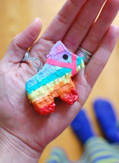 Link has tutorial for how to make pinatas, including this adorable mini pinata that could be attached to a gift bag or made into a keychain for a fun, unexpected, and inexpensive party favor!