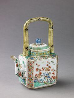 Porcelain teapot painted in overglaze famille verte enamels. Love the handle!