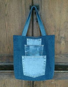 Pick a Pocket Tote Bag. Sturdy yet stylish, this large one-of-a-kind tote bag . Pick a Pocket Tote Bag. Sturdy yet stylish, this large one-of-a-kind tote bag will soon become your trusted compan Denim Handbags, Denim Tote Bags, Denim Purse, Jean Purses, Purses And Bags, Women's Bags, Denim Ideas, Denim Crafts, Diy Jeans