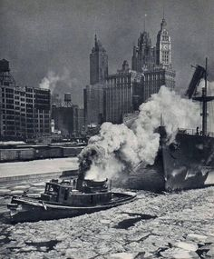 A tug boat pulls a ship off Lake Michigan, west along the river, 1935, Chicago.