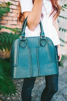 Green structured dome satchel with sophisticated raised quilting.