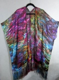 This one-of-a-kind fringed kimono cover-up was hand painted using fiber reactive dyes. The process is similar to painting with watercolors, but then the dyes are steam set to make the dyes permanent and fade resistant. I have painted this piece using a rainbow array of dye colors--yellow,