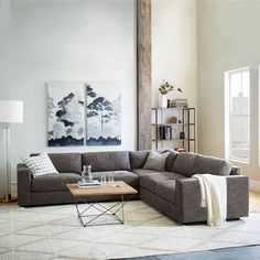 Spacious and stylish, the Urban Sectional is perfect for parties and family movie nights alike. Hand-upholstered and assembled in the USA, it's stocked in a durable heathered tweed with deep seats and down-wrapped cushions. You won't want to get up, trust us.