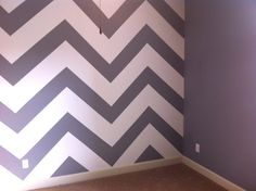 Finished painting Addison's room! Her room is still empty because I am painting her bed and dresser but here it is. Chevron gray and white for the main wall and gray for the other 3 walls. She loves it and so do I! Woot woot!
