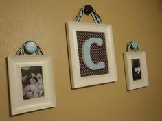 using knobs to hang pictures rather than nails...cool!