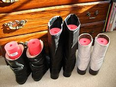 A pool noodle in place of boot stands! So much cheaper and you can cut them to fit shorter boots. GOOD IDEA