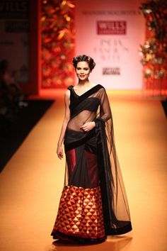 Vogue India's Top #Trends: 11 NEW WAYS TO WEAR THE #SAREE (here Manish Malhotra layered his sheer black sari over a red metallic ghagra)