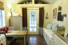 Tiny house interior good use of living/dining space. more windows would be good