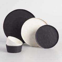 Crafted in Portugal of stoneware in a sleek, organic shape, our black dinner plates feature unique rimmed lips for a modern look. Pair them with your existing dinnerware, or set a complete table with our full collection. Modern Dinner Plates, Dinner Plate Sets, Dinner Sets, Dinner Ware, Black Dinnerware, Dinnerware Sets, Rustic Dinnerware, Modern Dinnerware, Le Creuset
