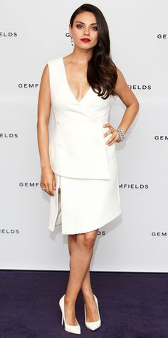 Mila Kunis suited up in the most ladylike way possible for the launch of Gemfields Mozambican Rubies in a crisp white sleeveless plunge-neck double-breasted Antonio Berardi tuxedo dress with zip-slit detailing. She accessorized with a sparkler of a bracelet, ruby red lips, and black Kurt Geiger London pumps.