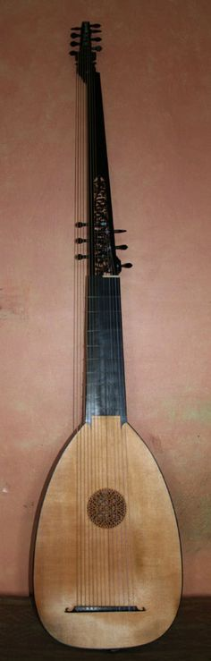 French continuo theorbo - used specifically along with a keyboard instrument to provide steady bass harmony for a highlighted group of singers or instrumentalists.