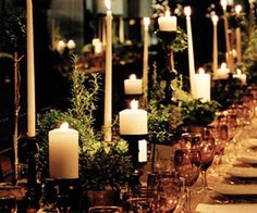 rustic feeling with rosemary and other herbs on the table along with candles