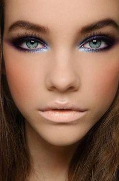 Ice blue eyes, nude lips.
