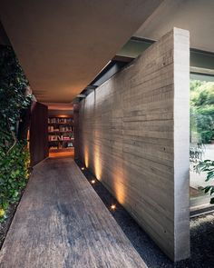 House entryway front door. Covered walkway, calm lighting, simple materials, calm experience. Casa Sierra Leona by JJRR/ARQUITECTURA