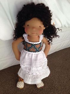 "Dear Maya is a custom order 20"" Evergreen Baby natural fiber art doll. She has a needle felted face, ears, knees, elbows, sculpted bottom and belly button. She has brown/black tight curly mohair weft for hair. Maya was born in early 2015."