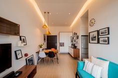 Spaciousness greets visitors as soon as they step into Emily's haven, an apartment in Taiwan. With light streaming in through the full-length windows awashing the airy space with sunshine, as well as cove lighting that illuminates the ceilings for an illusion of height, her apartment is remini...;