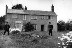August 1963: Police stand guard outside Leatherslade Farm at Oakley in Buckinghamshire, used as a hide-out by the Great Train Robbers