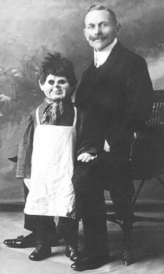 Um. What is going on here? Is that a ventriloquist dummy dressed up like a butcher? Freaking me out.