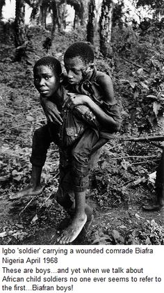 A child soldier helping a fellow comrade