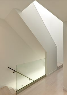 27 Coltman Townhouses / Dimit Architects white wash bamboo glass stair railing