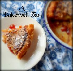 The English Kitchen - A Bakewell Tart - A delicious British traditional tart.  Puff pastry, spread with raspberry jam and topped with an almond frangipane topping. My absolute favorite sweet from our time living in England.