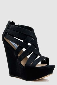 Strappy Steve Madden black wedged sandals.