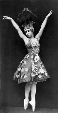 """Ballerina Lydia Lopokova posing in costume for the ballet """"Firebird,"""" English, 1919. Photo by E.O. Hoppe."""