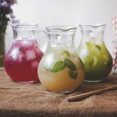 A Trio of Summer Beverages: Hibiscus Honey Lemonade, Peach Ginger Iced Tea, and Honeydew Agua Fresca.