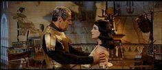 As Julius Cesar opposite Elizabeth Taylor in Cleopatra