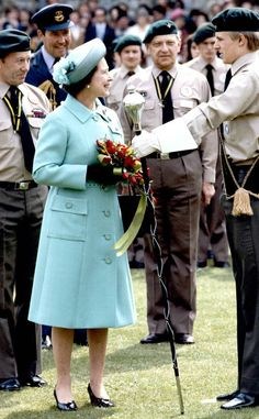 1982 from Queen Elizabeth II's Royal Style Through the Years  The Queen attended the parade of Queen's Scouts on the grounds of Windsor Castle in a robin egg blue coat and hat.