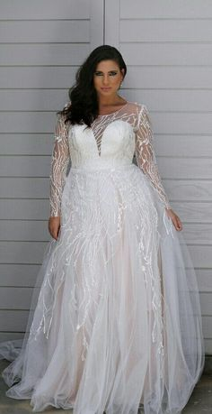 Sheer long sleeve plus size bridal dresses can be made for you in any measurements. This unique empire waist lace bridal gown can be made with any changes. We make custom #plussizeweddingdresses specific to the bride that are affordable. We also make inexpensive #replicas of couture designer #weddingdresses too. If the dress of your dreams is out of your price range we can help. Our inspired version will have the same style & look but will cost much less than the original.
