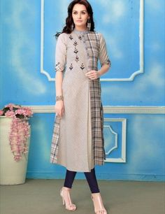 Check and stripes cotton kurti with embroidery motives and buttons detailing.