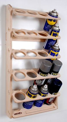 I was getting tired of my spray cans taking up shelf space and constantly falling over so I designed and cut this rack out on our CNC machine using 1/2 Baltic Birch. The quality is fantastic and It works great. Easy to mount using two screws. It also has a little pocket to store nozzles and those