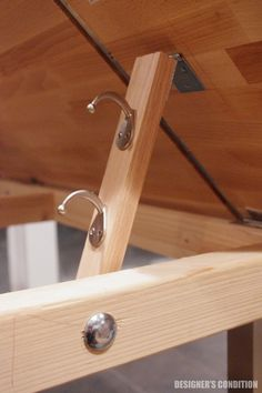 Multi-Kid Drafting Table | Designer's Condition. Uses coat hooks and carriage bolt to adjust angle of the top.