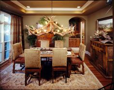 Faudroy Manor is a luxury French country house plan featuring a large covered patio with outdoor living spaces so you can enjoy time with family and friends. This luxurious dining room is cozy place to gather. To see more photos of this house plan, click here: http://www.dfdhouseplans.com/plan/8381/