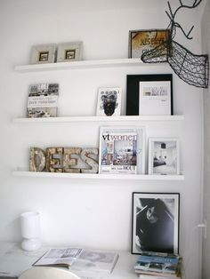 Use plain white shelves to display and change items regularly for inspiration.