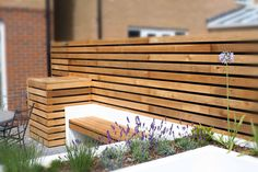 Great Small Garden Wall Ideas With Modern Decor Backyard Ideas Wooden Wall Furnished Garden Design Pictures Chairs Table And Two One Purple Flowers In Pots Amazing Modern Garden Design Urban Garden Design, Design Patio, Garden Wall Designs, Contemporary Garden Design, Modern Landscape Design, Small Garden Design, Modern Landscaping, Backyard Landscaping, Landscaping Ideas