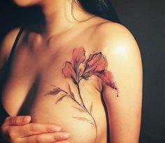 Flower tattoo by Tattooer Nadi