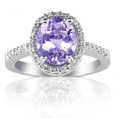 Oval Cut Amethyst Diamond Engagement Ring - There's Elegance in this Oval Cut Amethyst Diamond Engagement Ring. This ring is set with 30 Brilliant Cut White diamonds. It has a very good cut is high color quality & diamond clarity. The Amethyst ring's shank is also made of fully-hallmarked 14K White Gold with a total gem weight of 2.09 carats. All of the diamonds are 100% natural, not enhanced or heat-treated. #unusualengagementrings