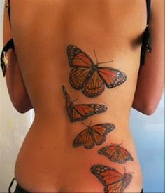 Butterfly watercolor tattoos on lower back for woman. Follow me: forever_wild1 for more!